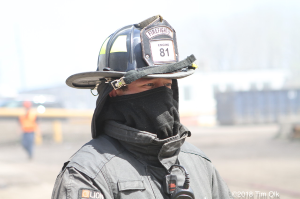 firefighter with Nomex hood to block smoke