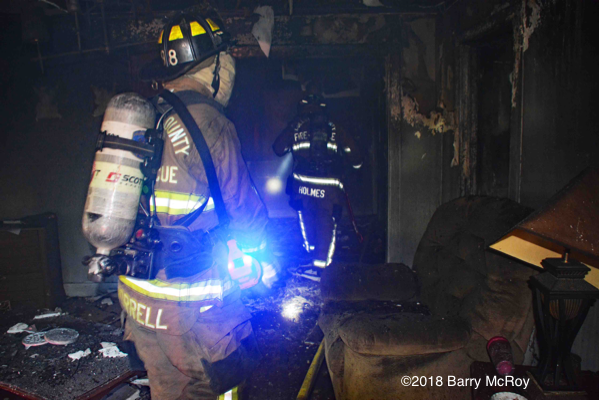 Firefighters inside house after a fire