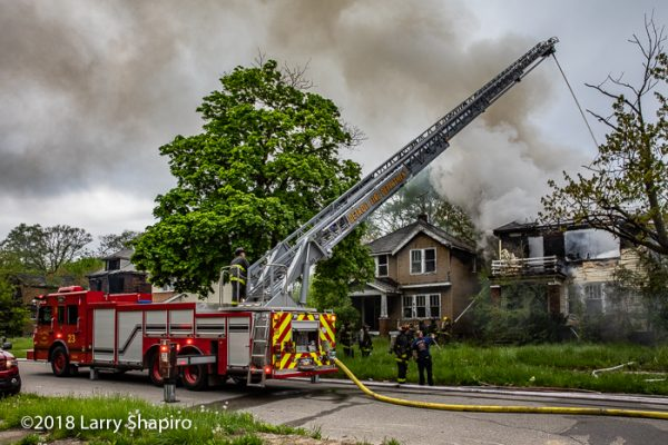 Smeal aerial ladder at work during Detroit house fire