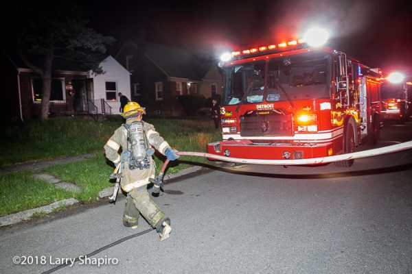 Detroit Firefighter pulling a red line