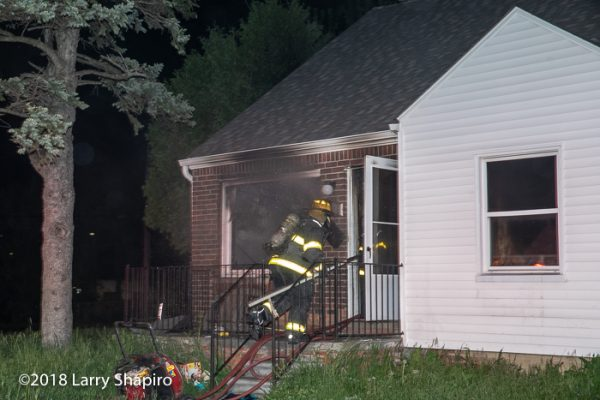 Detroit Firefighter entering a house on fire