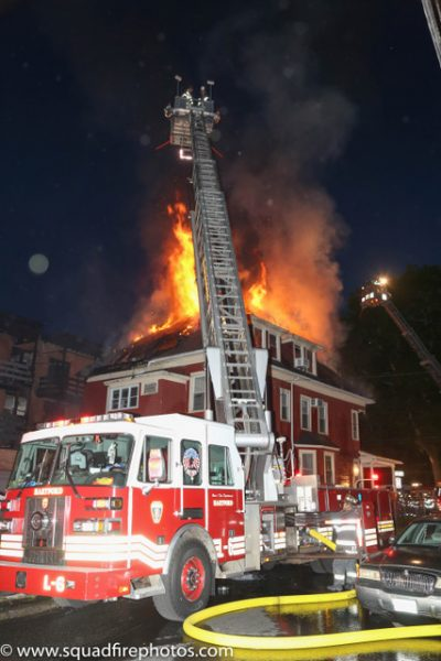 Sutphen tower ladder battling fire