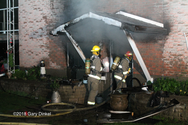 Firefighters in Woolwich Township Ontario battle a house fire at night