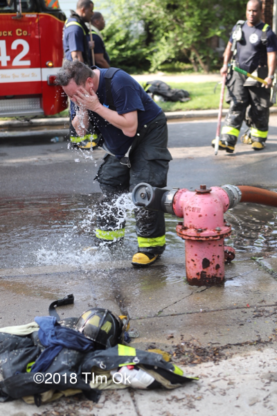 Firefighter cooling off on a hot day