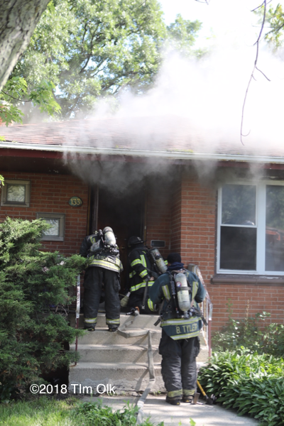 Firefighters enter house on fire