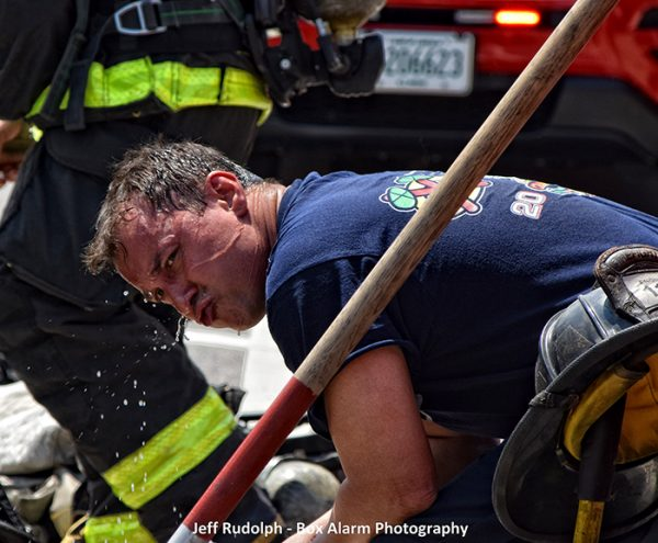 Firefighter cooling off on a hot day after a fire