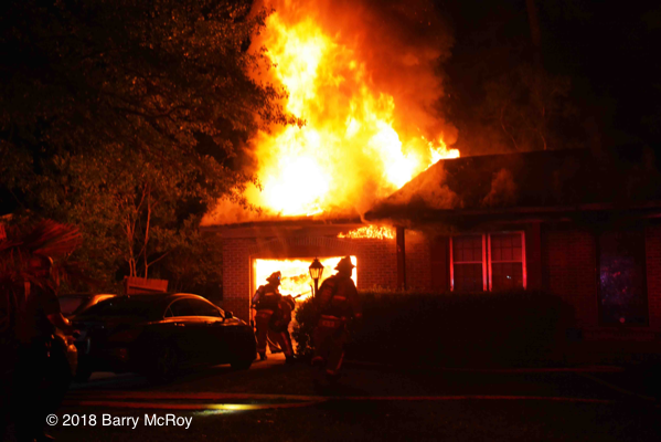 Colleton County firefighters battle a house fire at night