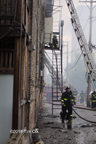 Firefighter in alley with fire escape