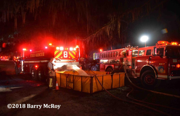 Colleton County SC Fire Rescue with rural water supply operations at a house fire