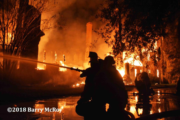 Firefighters battle South Carolina plantation house engulfed in fire