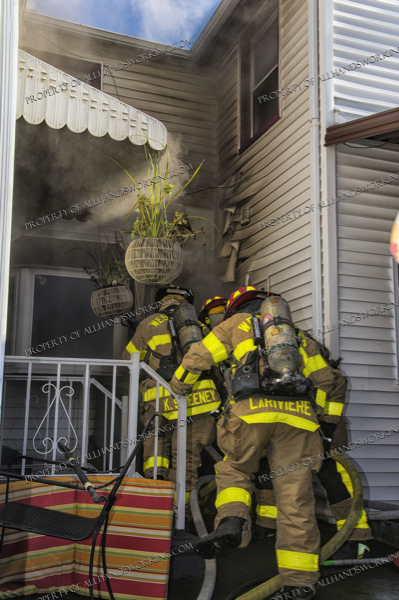 Firefighters enter house filled with smoke