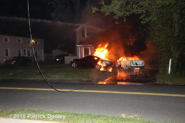 car engulfed in flames spreads to house
