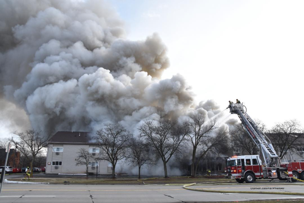 Sutphen tower ladder battles massive fire