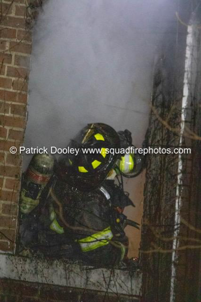 Firefighter at fire scene with smoke