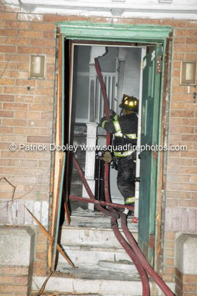 Firefighter in stairwell with hose