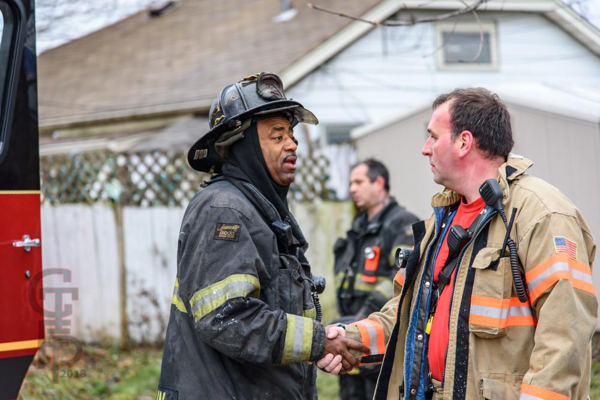 African American and white Firefighters shaking hands