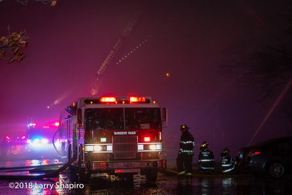 fire engine shrouded in smoke at night