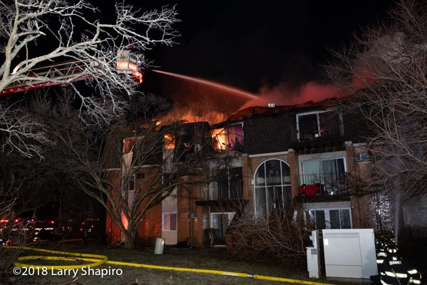 apartment building with Mansard roof on fire