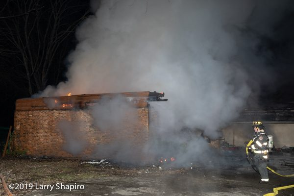 house destroyed by fire at night