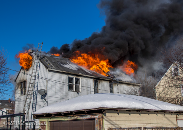 massive flames and smoke from house on fire