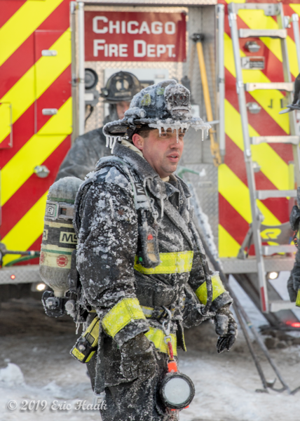 Firefighter covered with ice after battling a fire