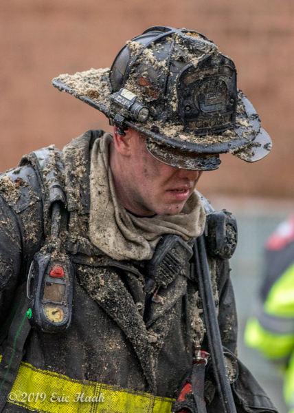 Chicago FD Firefighter covered with insulation after overhauling a fire