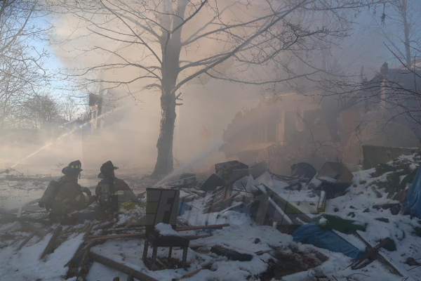 Firefighters battle house fire in the snow