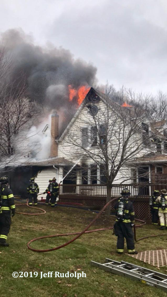 Firefighters battle large house fire