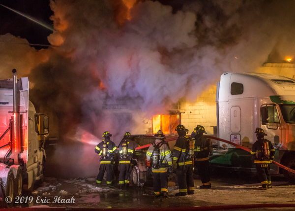 Firefighters battle frigid temperatures and huge fire at truck repair shop