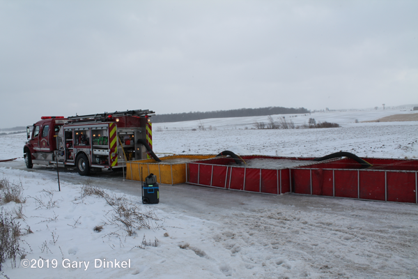 rural water supply at fire scene with multiple portable tanks