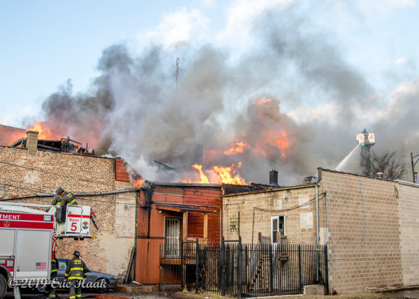 commercial building fire with smoke and flames