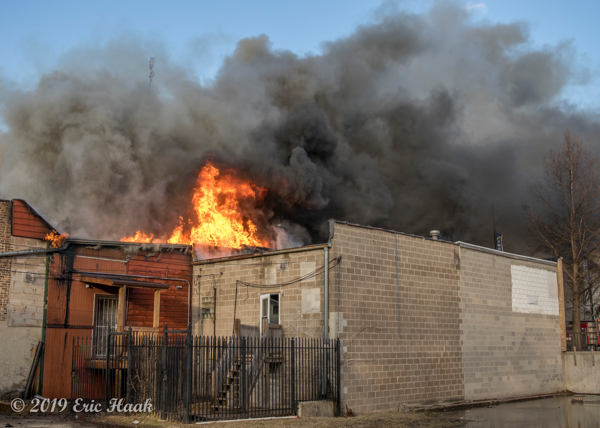 massive smoke and flames from commercial building fire in Chicago