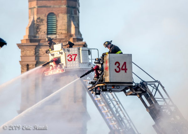 dual Chicago FD tower ladder buckets with master streams