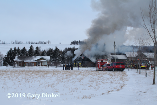 winter house fire scene in Canada