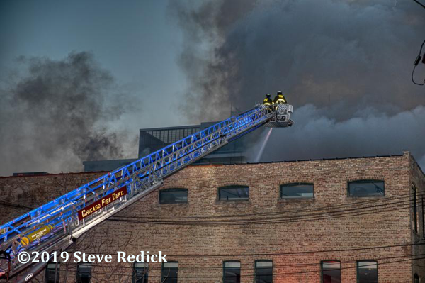 Chicago FD tower ladder at work