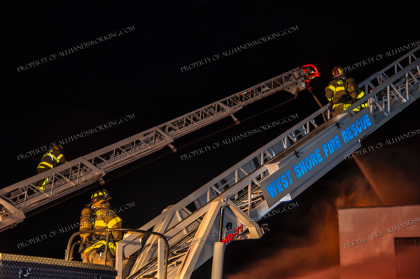 two aerial ladders up at night fire scene