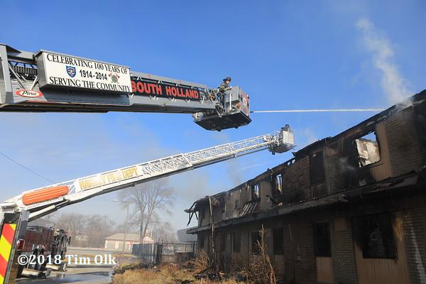 South Holland FD tower ladder at work