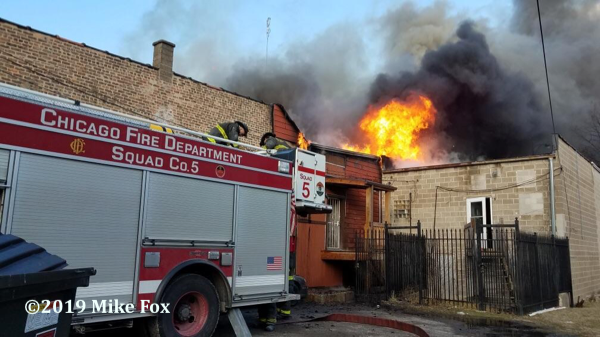 smoke and flames from commercial building fire in Chicago