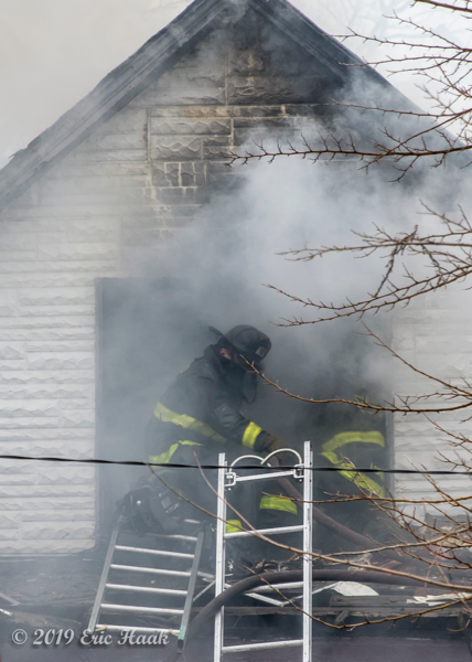 Firefighters overhaul fire with lots of smoke