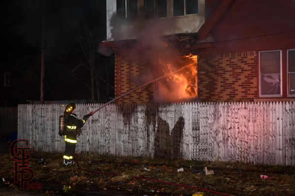 Detroit firefighter with hose line at fire scene