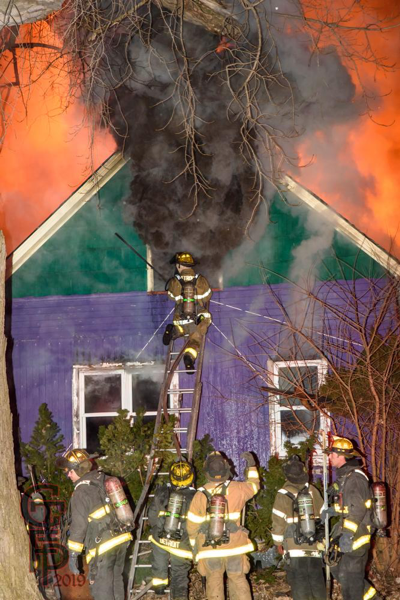 heavy smoke from attic during house fire