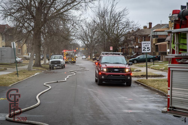 hose in street at Detroit fire scene