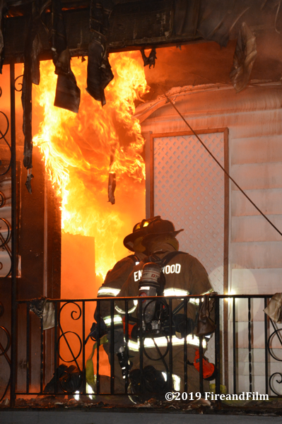 Firefighters enter building with massive flames