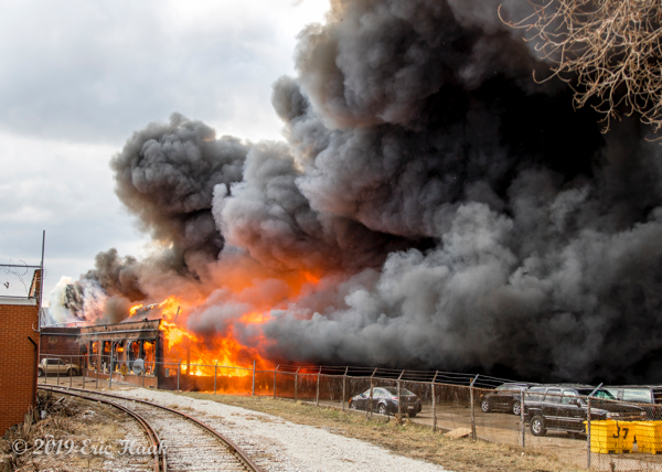 massive flames and smoke from industrial building fire in Chicago