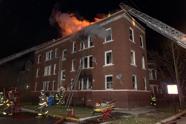 fire in a 3-story apartment building in Chicago at night