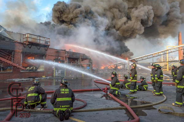 Firefighters with multiple lines battle massive warehouse fire