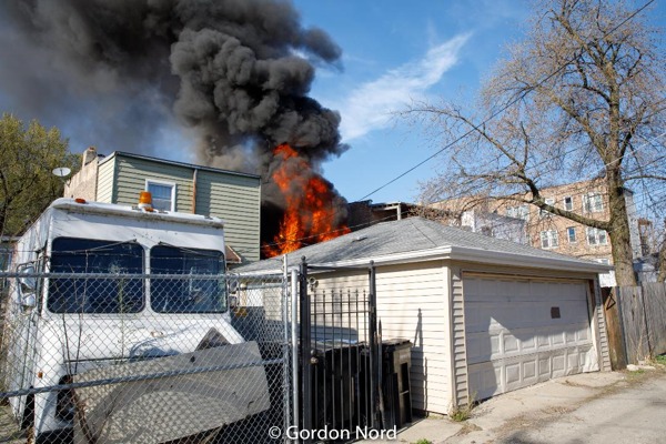 smoke and flames from back porches on fire in Chicago