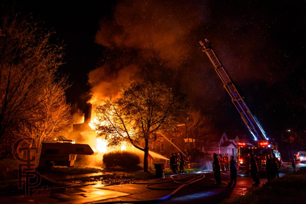 Detroit Firefighters battling fire in a vacant house that was going throughout
