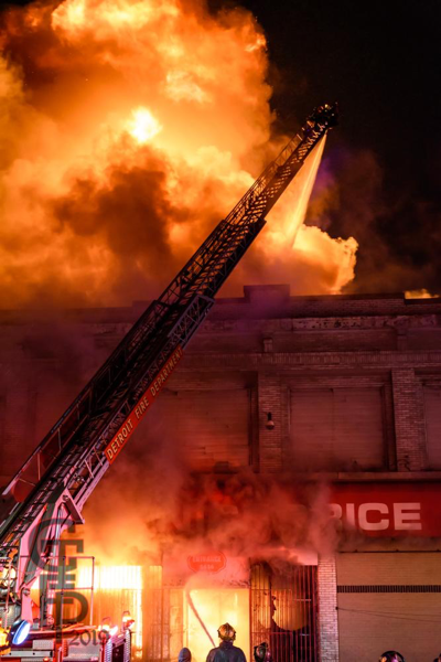 Detroit Firefighters battle a 2-Alarm commercial building fire at night