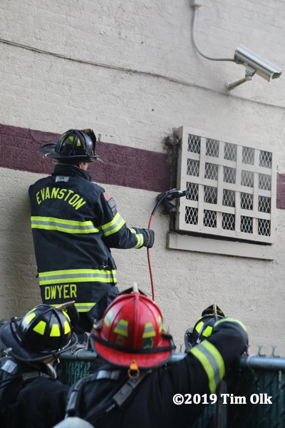 Firefighters vent commercial building fire